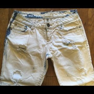 Like new bleached denim - distressed blue to white